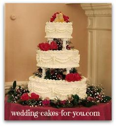 A Victorian wedding cake with fresh flowers and a kitty cake topper @wedding-cakes-for-you.com