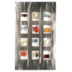jewels wall sculpture - a modern hand-painted and ground steel sculpture that frames different bold, jewel tone geometric shapes individually for dramatic effect.