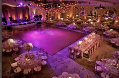 This looks a lot like how our wedding will be set up. Large dance floor and stage for the band and the same purple up lighting. I like the vision of this.