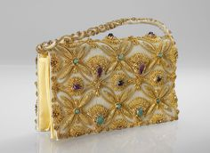 Evening bag embroidered with gold thread and amethysts, aventurine, citrines, rubies and star sapphires on silk. A true jewel...