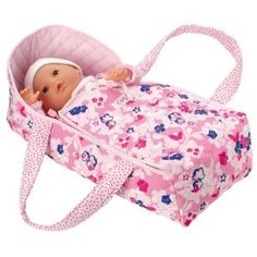 "Corolle Floral Carry Bed by Corolle. Save 22 Off!. $39.08. Inspires pretend play memories. Doll sold separately. Fits up to a 17"" Baby Doll. From the Manufacturer                This smartly styled floral print carry bed makes it possible for make-believe moms to take their baby along wherever they go. Fits up to a 17-inch baby doll.                                    Product Description                Corolle's Les Classiques Floral Carry Bed is the ideal accessory for any doll's mommy ..."