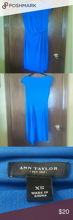 Ann Taylor Blue Sheath Dress- Size XS This is a vibrant blue dress by Ann Taylor.  Size XS.  Bought new and worn about 4 times before I grew out of it. Top of dress is lined, skirt of dress is not. Shell is 95% Polyester and 5% Spandex.  Lining is 96% Polyester and 4% Spandex. Machine washable.  Easy care. Still in very good condition. Ann Taylor Dresses