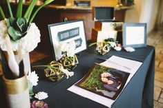 Photo album guest book with a framed wedding directory to escort guests to ceremony | Aubry Startin Photography | villasiena.cc