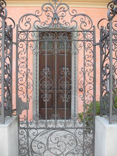 This juxtaposition of the gate over the doorway is beautiful Gate Way, Wrought Iron Gates, Iron Decor, Iron Work, Gate Design, Portal, Garden Gates, Porch Decorating, Windows And Doors