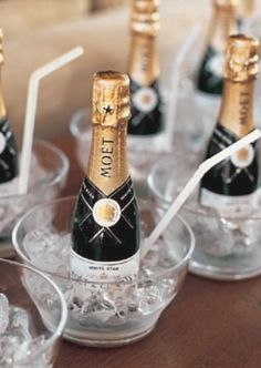 Love mini champagne bottles (with straws so you don't ruin your lipgloss!)