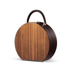 Bu Wood   BUMI w/ Wood   Tinkertailor.com American Walnut and Italian Calfskin. Lining in Vanilla Goatskin. Light Gold Color Brass. Dimentions: W22cm X H20cm X D8 cm
