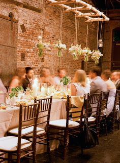 "rustic + modern ""chandelier"" over the head table 