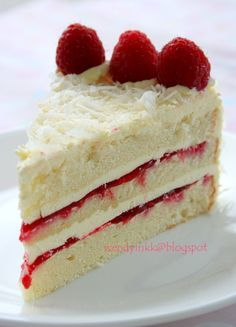Raspberry Lemon Cake - Delicious moist lemon cake packed with sweet raspberries! An easy to make crowd-pleaser! http://www.wendyinkk.blogspot.ca/2012/04/coconut-raspberry-lemon-cake-rasps.html
