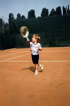 A very young Roger Federer takes to the court. - Courtesy of the Federer family