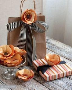 a simple brown paper bag embellished with ribbon & flower