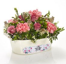 A change of job? Anniversary? Maybe a new home? Whatever the occasion, deliver this charming personalised trough of pretty pinks, delicious creams and grassy greens, right to their door. Just tell us what you want to say and we'll add your message for free!