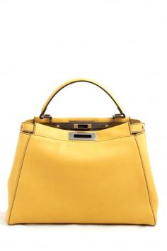 Fendi yellow Peekaboo regular. Yellow color leather handbag or shoulder bag. The bag is fully lined in fendi zucca canvas. Large zipped pocket inside. Fendi Spring Summer 2013 Collection.    Dimensions:  Bottom width: 34 cm; Bottom depth: 12.5 cm; Opening width: 28.5 cm; Height of the bag (excluding handle): 23 cm. Handle Height: 12 cm. Shoulder strap length: 110-140 cm.