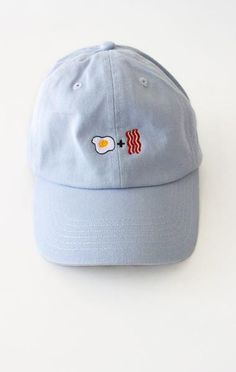 - Description Details: Six panel cap in light blue with 'Egg + Bacon' embroidery & adjustable back with tri-glide buckle. All accessories are final sa Dope Hats, Biker, Dad Caps, Outfits With Hats, Headgear, Light Blue, Baseball Hats, Purses, My Style