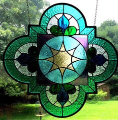 Arabesque turquoise, Purple, green, and pale purple Quatrefoil Stained Glass Panel, window, suncatcher gift, sun catcher by TreasuresOfLight on Etsy https://www.etsy.com/listing/240673436/arabesque-turquoise-purple-green-and