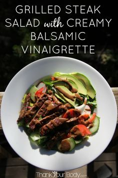 An easy summer dinner, this salad is topped with seasoned, grilled steak and drizzled with creamy balsamic vinaigrette dressing.