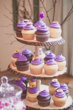 Purple cupcakes at a Rapunzel birthday party! See more party planning ideas at CatchMyParty.com!