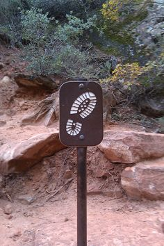 Trail sign in Zion National Park Running Signs, Park Signage, Wayfinding Signs, Trail Signs, Most Visited National Parks, Sign System, Center Signs, Outdoor Signage, Camping Theme