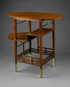 This table, designed by Edward William Godwin around 1872, demonstrates the ideals characteristic of the Aesthetic movement in Britain from the 1860s to 1880s. The overall composition of the table, with its attenuated lines and asymmetrical organization of stretchers and posts, creates a rhythm of horizontal and vertical elements that echo Asian as well as traditional English influences. Another example of this table was made in about 1871 for Godwin's wife, the actress Ellen Terry,