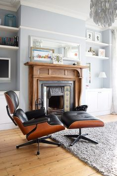 Our Edwardian living room with built in cupboards in the alcoves on each side of the fireplace. Our favourite piece of furniture is our Eames lounge chair - possibly the most comfortable piece of furniture ever? Living Room With Fireplace, My Living Room, Living Room Decor, Small Living, Modern Living, Dado Rail Living Room, Edwardian Haus, Victorian Living Room, 1930s Living Room