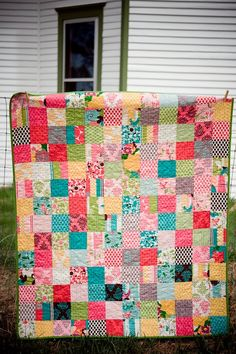 Quilt made of charm squares.