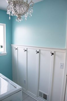 Chandelier and hooks in laundry room. But I can picture a bathroom like this too! @Kristi Jones