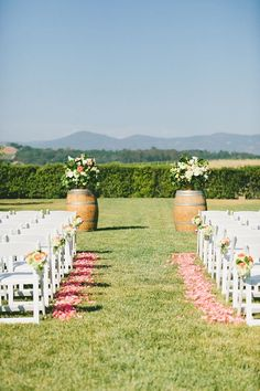 An outdoor vineyard wedding ceremony | @onelovephoto | Brides.com