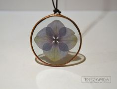 A personal favourite from my Etsy shop https://www.etsy.com/listing/270790543/stained-glass-jewelry-hydrangea-pendant
