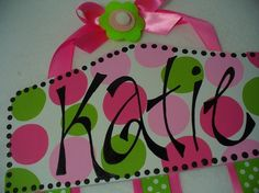 Pink/Green Bubble  24 inchs of double ribbon with Now with our signature bows with rhinestones at the ends of each ribbons. The felt flower embellishments are still available but you must request them at time of purchase.  Holds tons of bows.  Personalized using our own freehand funky font. NO STENCILS USED!  Wholesale Available.