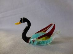 Check out this item in my Etsy shop https://www.etsy.com/uk/listing/524035341/vintage-colourful-swan-coloured-glass