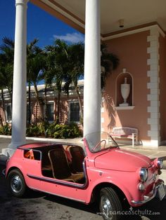 Pink Convertible with wicker seats, stylin' at the Lyford Cay Club, Nassau