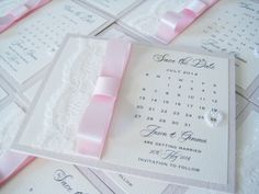 Pretty lace save the date cards with pink dior bow.