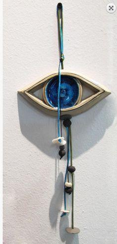 Evil eye ceramic wallart charm sculpture blue eye Dimensions: 17 cm x 40 cm Handmadeevil eye ceramic wall art charm unique piece made in our small and family
