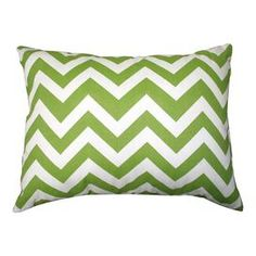 """Indoor/outdoor chevron lumbar pillow in green.   Product: PillowConstruction Material: PolyesterColor: Green and whiteFeatures: Insert includedChevron front and solid reverseDimensions: 12"""" x 16""""Cleaning and Care: Spot clean. Cover can be machine washed and air dried."""
