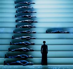 The different levels on stage effectively draw the eye upwards. The ice blue colour creates a hard atmosphere that is aided by the hard lines of the stairs. Stage Set Design, Set Design Theatre, Bühnen Design, Scenography Theatre, Theater, Scenic Design, Shows, Installation Art, Performing Arts