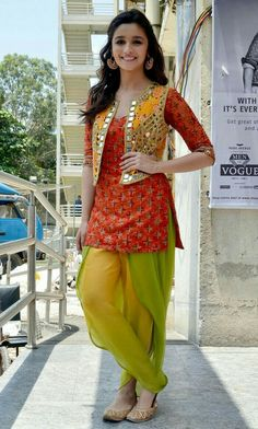 Punjaban look.in an orange kurta worn with a green Patiala salwar and a bright Arpita Mehta vest. Patiala Dress, Punjabi Dress, Pakistani Dresses, Indian Dresses, Indian Outfits, Pakistani Mehndi, Patiala Pants, Walima Dress, Churidar