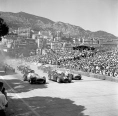 The start of the Monaco Grand Prix, Monte Carlo, 22nd May 1955. Juan Manuel Fangio and Stirling Moss in the Mercedes W196 bracket Alberto Ascari's Lancia D50 as Eugenio Castellotti's Lancia follows closely