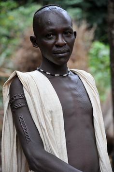 Kachipo young boy with scarifications and typical