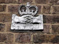 Fire Mark on No 5 Church Gate, Putney. These plaques showed that you were insured against fire.