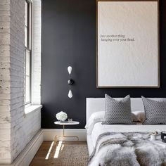 Art doesn't need to be colorful or graphic to make a huge impact above a bed.