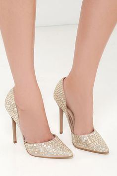 The Steve Madden Varcityr Gold Multi D'Orsay Pumps have a metallic blush upper that dips into d'Orsay cutouts on both sides, and is covered in dazzling silver and gold square metal accents.
