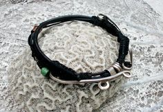 size: 8.3inch 21cm unisex Medium: black coral, sterling silver, tourquoise gemstone, copper, black beads, cotton wax string.    Very original design. One