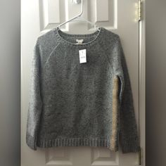 NWT Sweater with Gold Accent NWT Sweater by J. Crew 😊 It has gold lining on both sides which adds a feminine touch to it. J. Crew Sweaters Crew & Scoop Necks