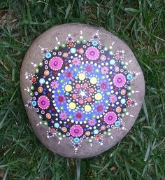 Painted rock mandala about 12 inches wide by B-Brilliant Decorative Painting