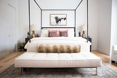 """Head to @liketoknow.it.home today, as CC and Mike from @ccandmikecreative take you on a tour of their Tulsa, OK home. """" Welcome to our Master Bedroom.  I'm still as obsessed with this canopy bed as the day I got it and our buffalo print (available in our print shop - www.ccandmike.com) kinda makes us smile every time we walk into this room.  Hope you enjoyed seeing our Master Bedroom and if you would like to see our master bath as well, you can head over to the blog to tour more of our home…"""