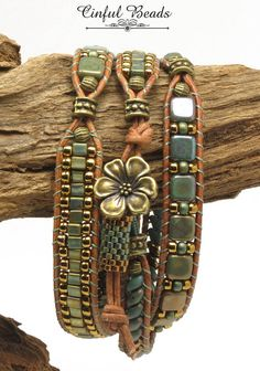 A stylish Bohemian bracelet. This bracelet has 3 sections and features different beads in each section. The first section is composed of turquoise copper picasso and bronze superduos. The center section is made of Czechmate tiles in turquoise bronze clay separated by Japanese seed