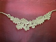 Mountain Gold is a necklace made by sewing crocheted motifs together free pattern