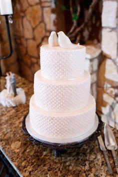 "White on white wedding cake with a ""Love Bird"" cake topper.Source: Kristi Wright Photography #lovebirds #weddingcake #white"