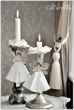 cut out paper dolls, gather up a coffee filter skirt hot glue all onto a silvr/white snowflake and hang. lovely!