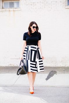 Black and white, with red shoes