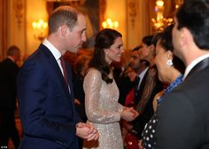 The Duchess of Cambridge dazzled in a glittering designer gown as she stepped out at a reception celebrating Britain's relationship with India tonight.
